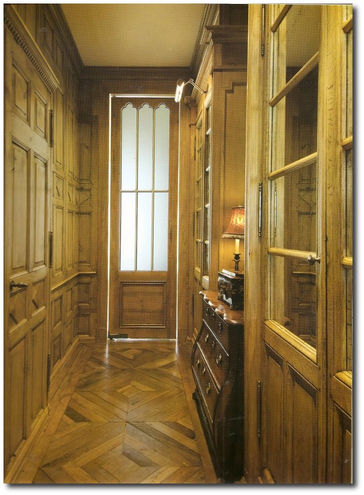 A-narrow-passage-leads-from-the-entry-way-to-the-kitchen_-Look-at-those-rustic-floors