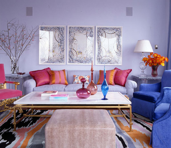 living-room-with-carpeting-and-colorful-pillows-and-a-beautiful-blue-sofa