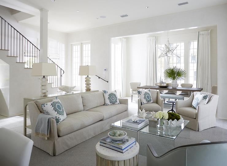beige-linen-skirted-sofa-acrylic-waterfall-cocktail-tables