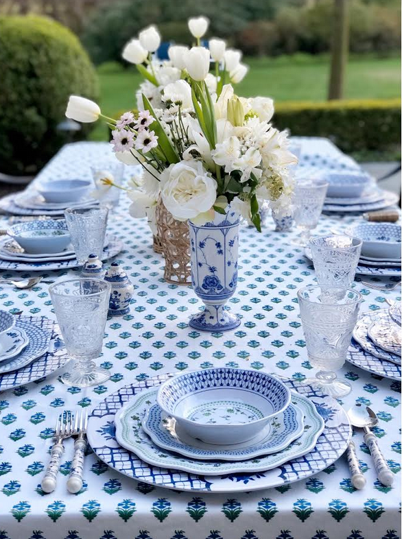 Setting a blue and white outdoor table….