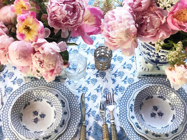 Setting a table with melamine and peonies